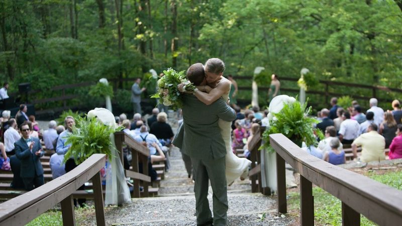Bride And Groom Hug At Outdoor Wedding Ampitheatre