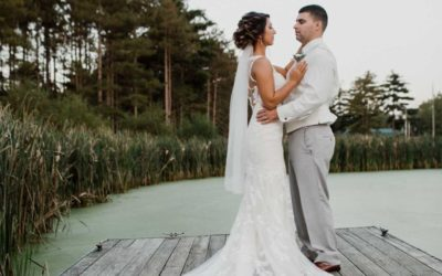 Bride And Groom On Lakes Dock
