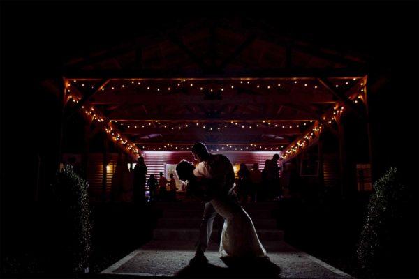 Couple Lit Pavilion At Night